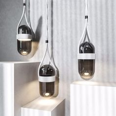 A glass pendant light with rope detailing.
