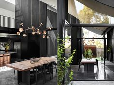 Adjacent to the kitchen in this modern house is the dining area, with a large sculptural light positioned directly above the wood and black metal table. #DiningTable #DiningArea