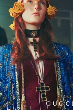 In an historic Italian ballroom in Turin, the Gucci Gift campaign unfolds. New Gucci Jewelry pieces include necklaces featuring pendants embellished with enamel details.