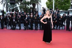Ludivine Sagnier puts her spin on the Valentino Fall/Winter 2018-19 long black dress by Pierpaolo Piccioli worn at the screening of 'Sink Or Swim (Le Grand Bain)' during the 71st annual #CannesFilmFestival. #Cannes2018