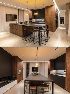 A black and wood kitchen with an island.