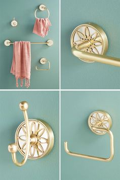 Metallic brass bathroom hardware with a delicate decorative motif.