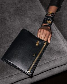 Women's accessories featuring the Alix Clutch, Padlock Leather Wrap Bracelet and Padlock Leather Bracelet. #TOMFORD