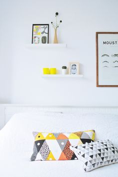 Bedroom inspo. White w/ graphic pops of colour. Add colour with a colourful bed cushion.