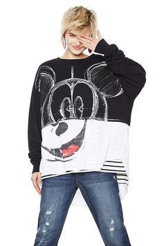 Women's black oversize sweatshirt with Mickey Mouse design in black and white. White fabric detail on the back with opening. You will never go out of style while wearing this jumper. Discover it on Desigual website.