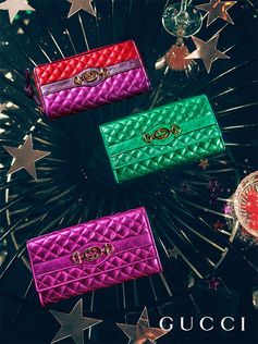 Photographs of the Gucci Gift party capture metallic leather wallets featuring the Interlocking G Horsebit—a symbol that merges two of the House's most distinctive codes into one.