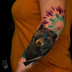 bear tattoo on forearm