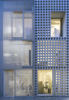 A Cross Pattern Covers This Facade Made From Precast Concrete