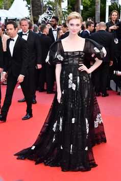 Actress Elizabeth Debicki attended the premiere of 'Solo: A Star Wars Story' at Cannes Film Festival wearing 'Samanta e Lucia', a black organza, taffetas and laminated lace dress with puffed sleeves from the Valentino Haute Couture Spring/Summer 2018 Collection designed by Creative Director Pierpaolo Piccioli. #Cannes2018