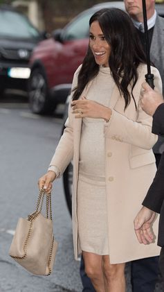 The duchess of Sussex Meghan Markle wearing a Stella McCartney Spring 2019 Falabella bag.