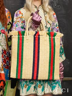 From Gucci Pre-Fall 2018, a new straw bag crafted from an all-natural material features woven stripes that play with the colors of the House Web.