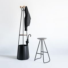 A modern umbrella stand with coat rack, and a matching stool.