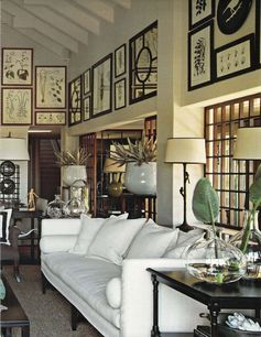 The Guest House at Hibiscus Hill | Design by India Hicks. Stunning dining room designed by Alanna Smit Designs and photographed by Simon Whitbread. The beautiful vintage window frame turned mirror is from Manyara Home, topped off with white, rattan, palm leaves and a giant clamshell – just beautiful! Tropical bathroom via Fanimation. The rattan fan …