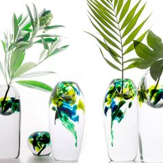 A glass vase with delicate colors inspired by rainforests.