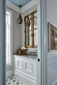 Metrie's Fashion Forward baseboard makes a grand appearance in Sarah Richardson's powder room.