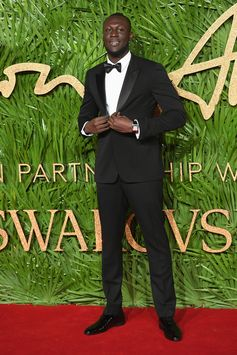 Wearing a black Burberry tuxedo, Stormzy arrives at the 2017 Fashion Awards in London