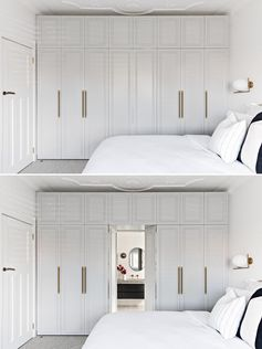 In this contemporary bedroom, light grey closets hide the entry to the bathroom.