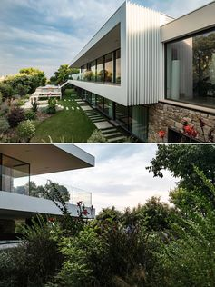 A concrete and steel house extension with glass walls.