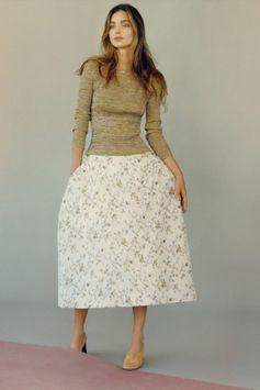 Miranda Kerr wearing Celine Soft Ballerina Pump in Tan Nappa Lambskin and Christian Dior Spring 2015 Skirt
