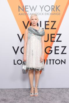 Michelle Williams wearing a look from the Spring-Summer 2018 Collection by Nicolas Ghesquiere at the opening of the Louis Vuitton Volez, Voguez, Voyagez Exhibition at the historic American Stock Exchange in New York City.