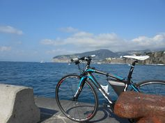 BH Prisma Sport, flat bar carbon road bike, by the sea.