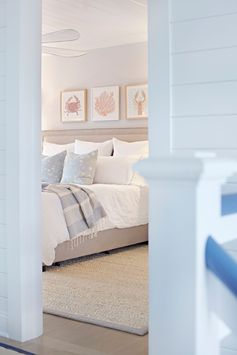 Coastal décor ideas | Frames above bed | Coastal design style | Shiplap walls hallway