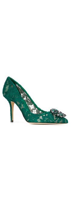 These lace pumps by Dolce & Gabbana offer an unexpected hint of skin where you can find these women's pumps in muted and colour popping hues. Find the best collection of Belluci pumps at Farfetch.