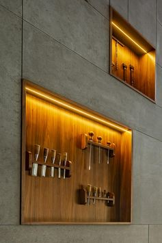 Wood-Lined Shelves With Hidden Lighting Add Interest To These Oversized Lobby Walls