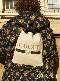 A reference to restro-style prints from the 80s, the Gucci vintage logo appears on a new leather drawstring backpack.