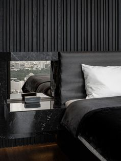 This Bedroom's Textured Accent Wall Was Made With A Variety Of Black Stained Vertical Wood Slats