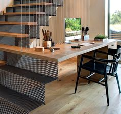 A Desk Was Combined With These Stairs To Create A Small Home Office