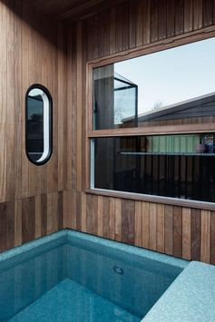 Swimming Pool Ideas - A blue-tiled plunge pool has been built into a small alcove at the side of this modern house. #PlungePool #SwimmingPool #Architecture #Windows