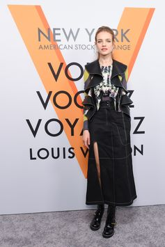 Nathalia Vodianova wearing a look from the Spring-Summer 2018 Collection by Nicolas Ghesquiere at the opening of the Louis Vuitton Volez, Voguez, Voyagez Exhibition at the historic American Stock Exchange in New York City.