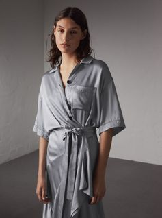 An anytime-anywhere tie-waist shirt dress made from washed silk satin for a fluid fit. The skirt is cut on the bias with an undulating hem, which is slightly raised at the front, for flattering definition.