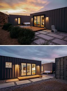 A modern shipping container house that's made from three separate containers and is painted dark grey.