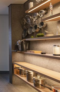 Use Hidden Lighting Under Shelves To Create A Dramatic Wall