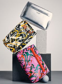 Small wonders from Burberry. Discover the pouches in Trench Leather, available in metallic and splash prints.