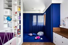 These modern kids bedrooms have raised beds with storage, and custom designed play areas. #KidsRoom #ChildsBedroom #ModernKidsRoom