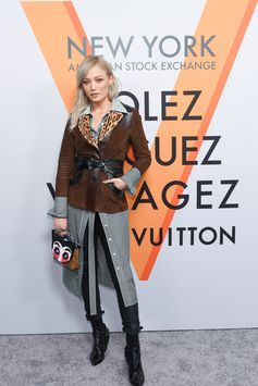 Pom Klementieff wearing a look from the Cruise 2018 Collection by Nicolas Ghesquiere at the opening of the Louis Vuitton Volez, Voguez, Voyagez Exhibition at the historic American Stock Exchange in New York City.