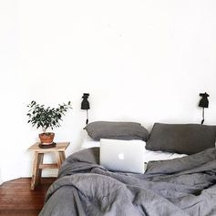 these cozy gray blankets look like a perfect spot to cozy up on a snow day!