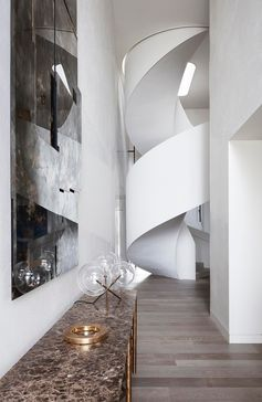 White spiral stairs in a modern interior.