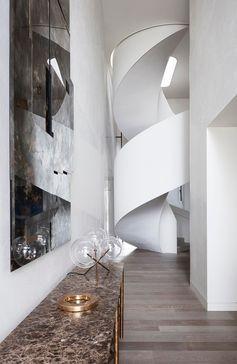 White spiral stairs in a modern interior.