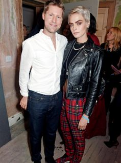 Cara Delevignge wears Burberry alongside Christopher Bailey at the September runway show.