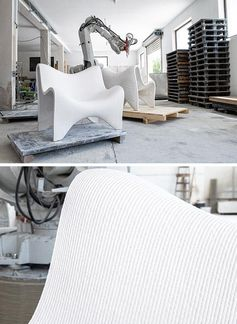 A pair of 3D printed outdoor chairs made from concrete.