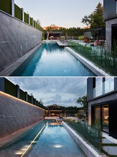 A modern swimming pool with hidden lighting.