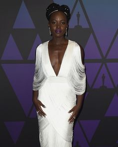 Lupita Nyong'o wore an ivory draped TOM FORD fringe evening gown to the Academy of Motion Picture Arts and Sciences 10th Annual Governor's Awards in Los Angeles. #TOMFORD