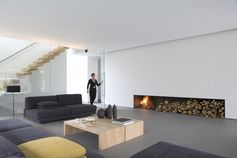 Minimalistic fireplace and yet cosy in a very contemporary way.