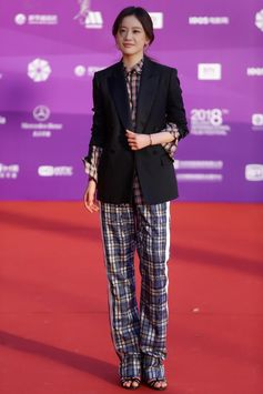 Actress Vivien Li wearing Burberry Evening Jacket with Check Cotton Silk Shirt and Tailored Track Pants while attending the 8th Beijing International Film Festival