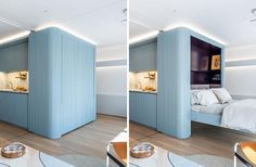 A blue wall with a hidden fold-down murphy bed.