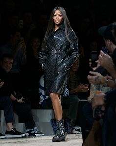 Monogram Eclipse Glaze on Naomi Campbell at the Louis Vuitton Fall-Winter 2018 Fashion Show by Kim Jones. See all the looks now at louisvuitton.com.